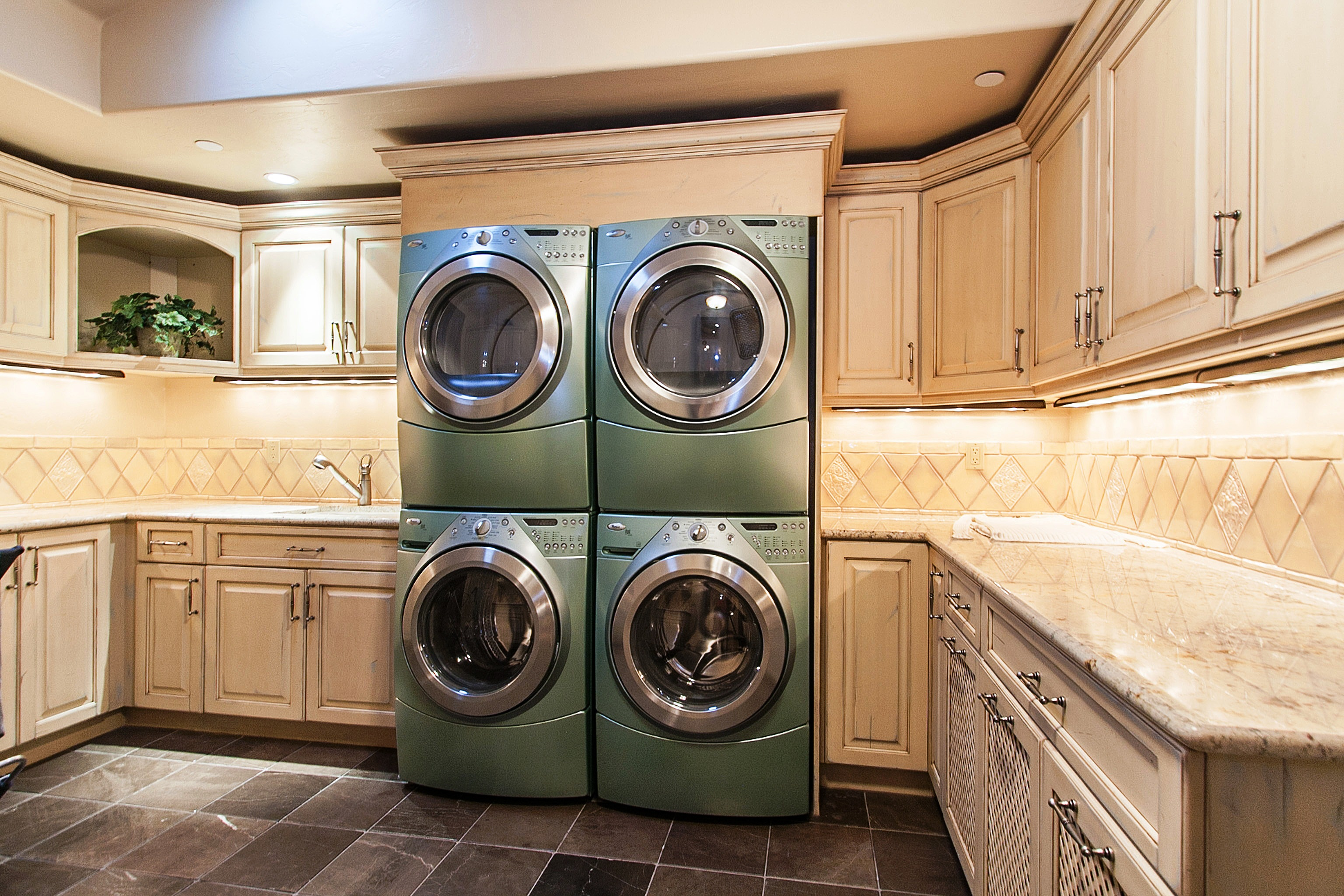 Efficient elegant laundry rooms come out of hiding for House plans with large laundry room