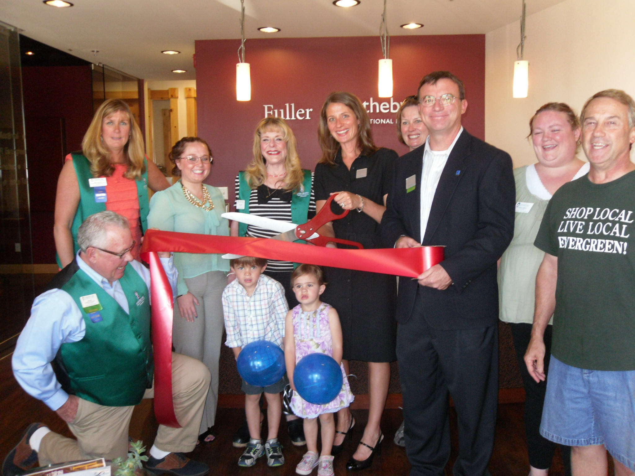 FSIR Evergreen broker, Christy Schoonover, assisting in the EACC ribbon cutting