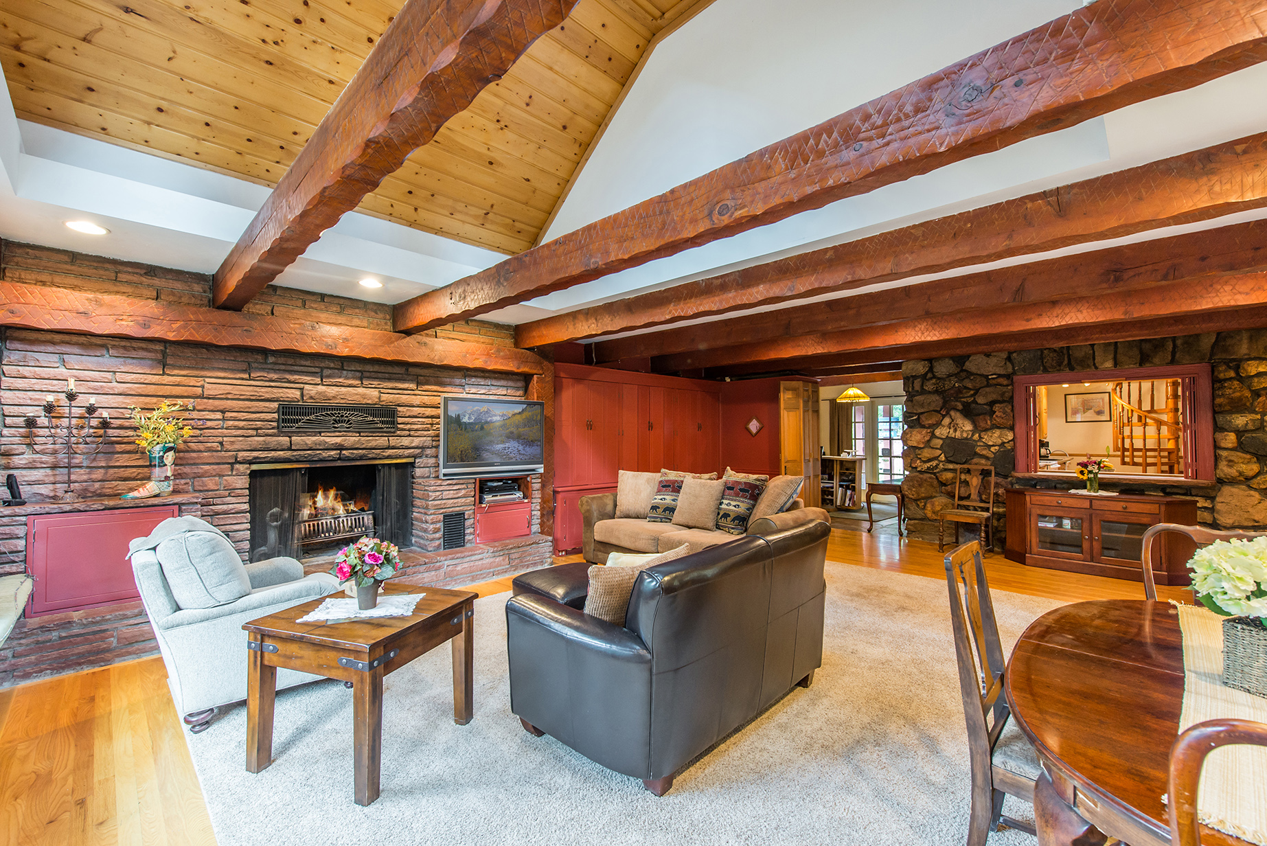 The Alpen Way Chalet Inn, located at 4980 Highway 73 in Evergreen, CO. Listed LIV Sotheby's International Realty for $1,199,000.