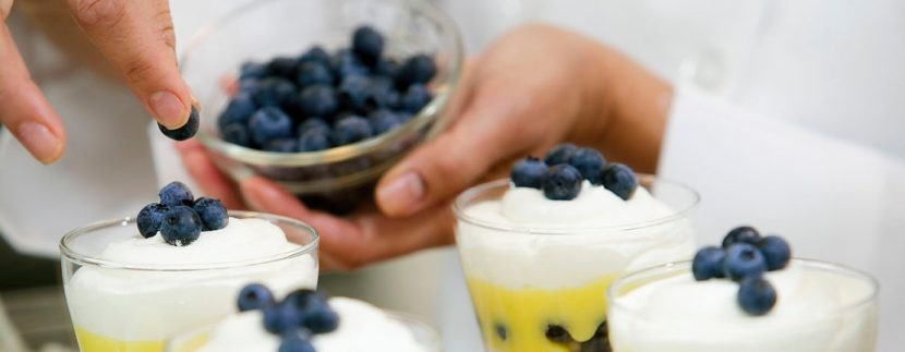 Chef with blueberry parfaits