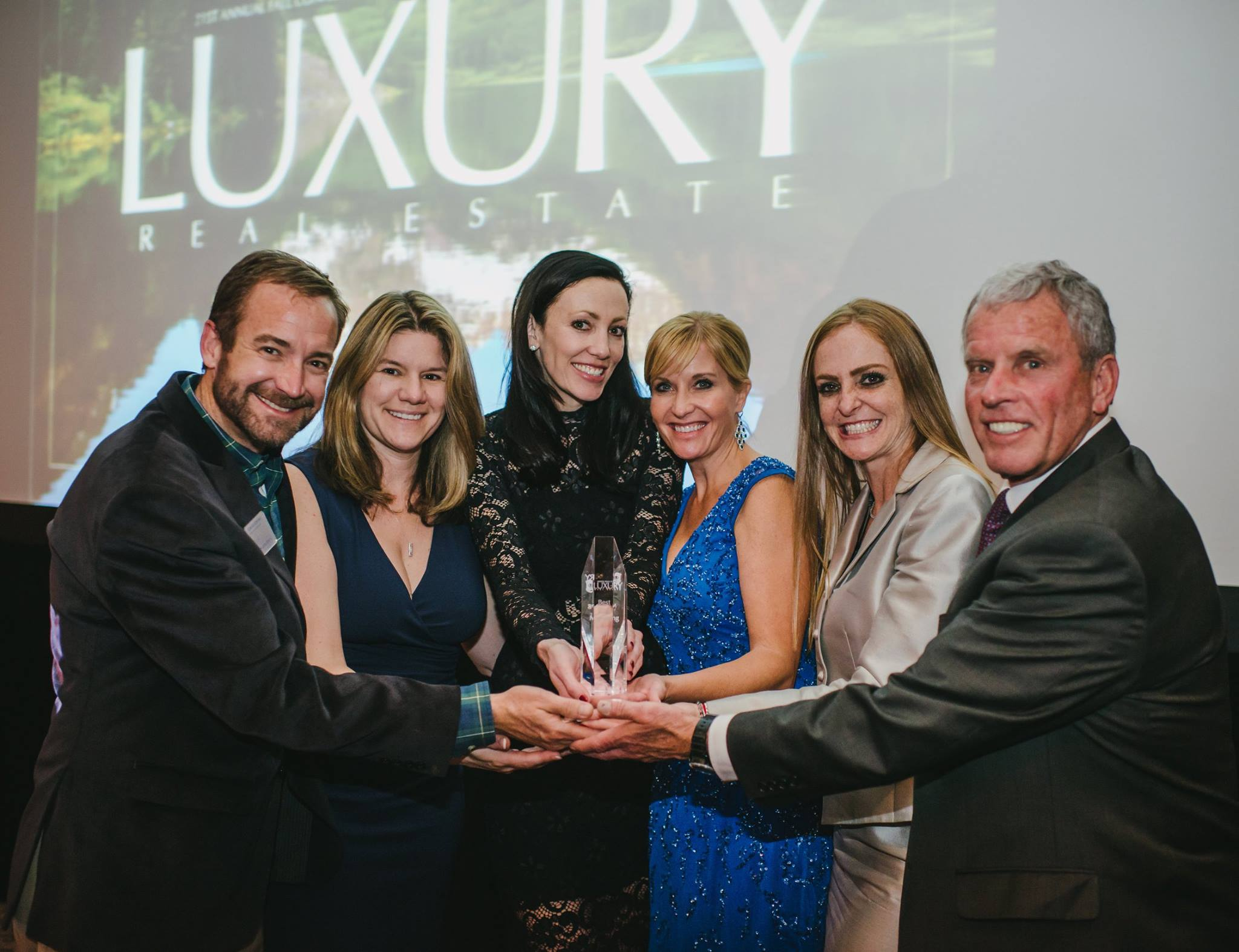 LIV Sotheby's International Realty team accepts 'Best Print Marketing Award' at 21st Annual Luxury Real Estate Fall Conference in Aspen, CO.